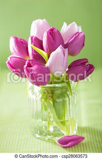 beautiful purple tulip flowers bouquet in vase - csp28063573