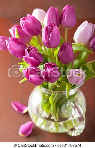 beautiful purple tulip flowers bouquet in vase - csp31767574