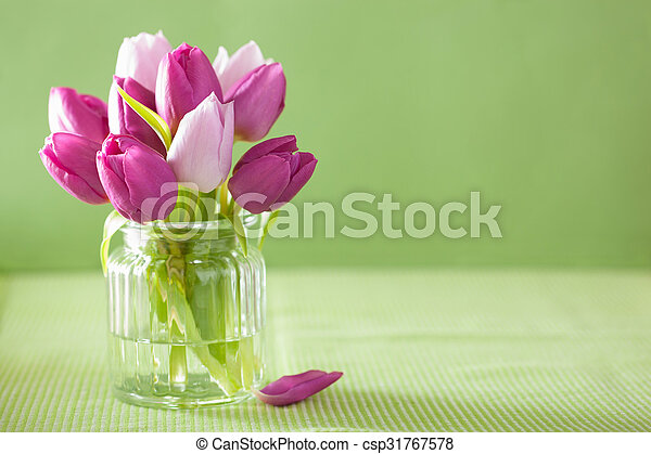 beautiful purple tulip flowers bouquet in vase - csp31767578