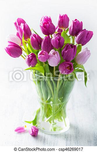 beautiful purple tulip flowers bouquet in vase - csp46269017
