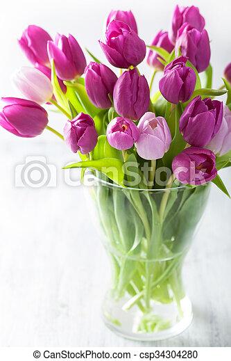 beautiful purple tulip flowers bouquet in vase - csp34304280