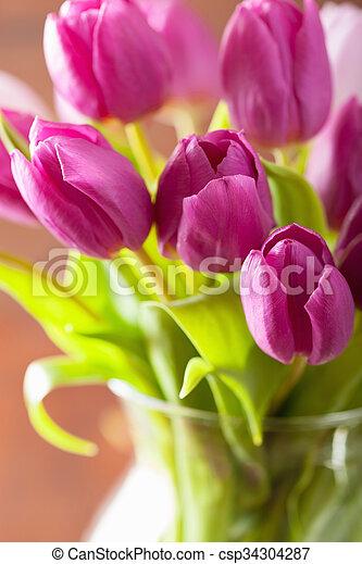 beautiful purple tulip flowers bouquet in vase - csp34304287