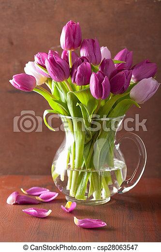 beautiful purple tulip flowers bouquet in vase - csp28063547