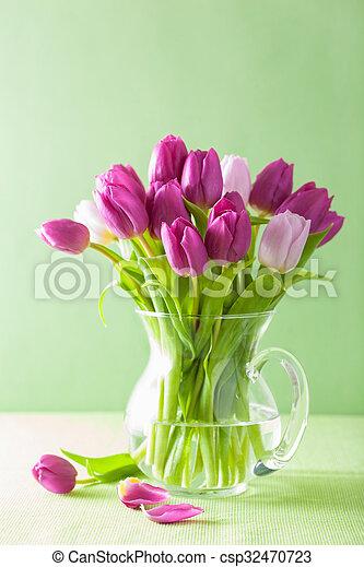 beautiful purple tulip flowers bouquet in vase - csp32470723