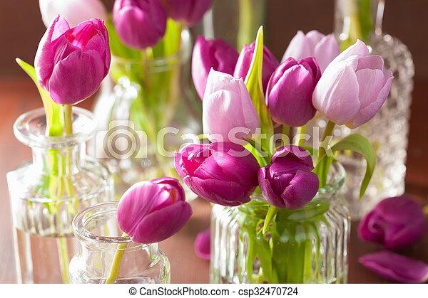 beautiful purple tulip flowers bouquet in vase - csp32470724
