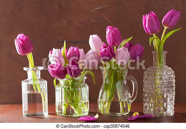 beautiful purple tulip flowers bouquet in vase - csp35874546