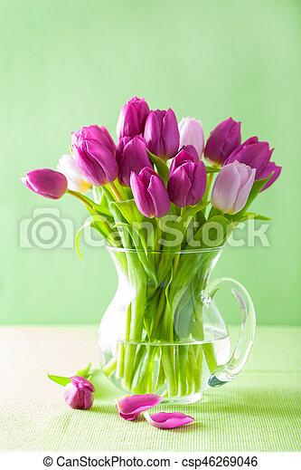 beautiful purple tulip flowers bouquet in vase - csp46269046
