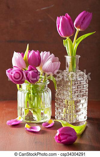 beautiful purple tulip flowers bouquet in vase - csp34304291