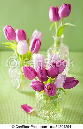 beautiful purple tulip flowers bouquet in vase - csp34304294