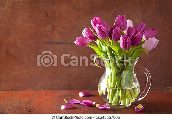 beautiful purple tulip flowers bouquet in vase - csp45857005