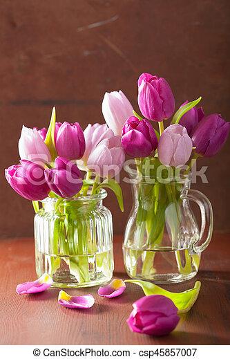 beautiful purple tulip flowers bouquet in vase - csp45857007