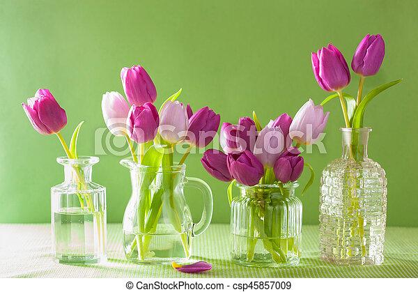 beautiful purple tulip flowers bouquet in vase - csp45857009