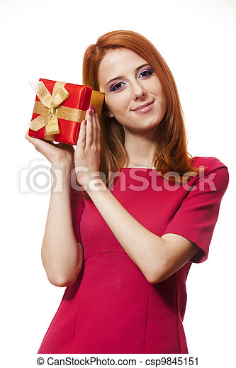 Beautiful red-haired woman with present box. - csp9845151