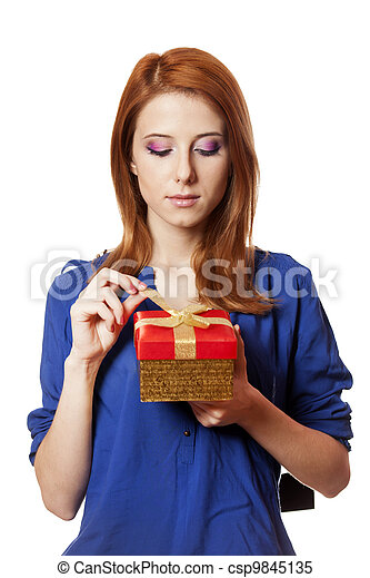 Beautiful red-haired woman with present box. - csp9845135