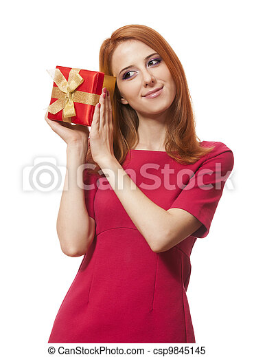 Beautiful red-haired woman with present box. - csp9845145