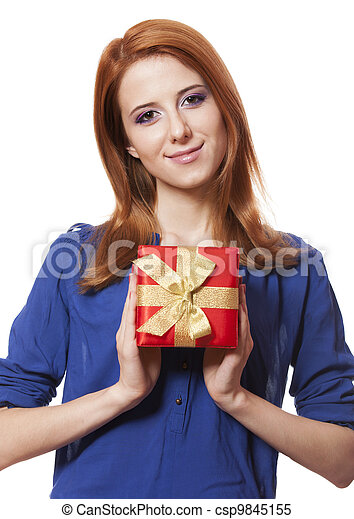 Beautiful red-haired woman with present box. - csp9845155
