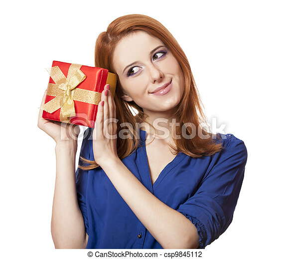 Beautiful red-haired woman with present box. - csp9845112