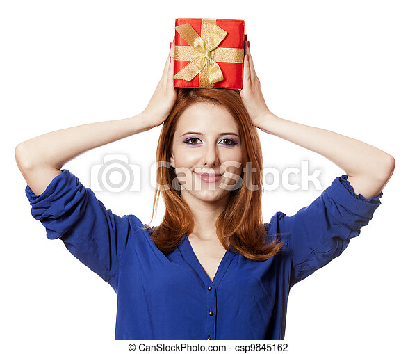 Beautiful red-haired woman with present box. - csp9845162