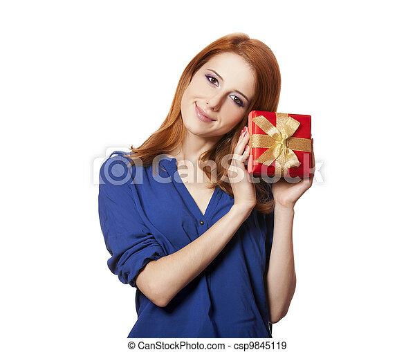Beautiful red-haired woman with present box. - csp9845119