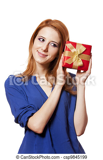 Beautiful red-haired woman with present box. - csp9845199