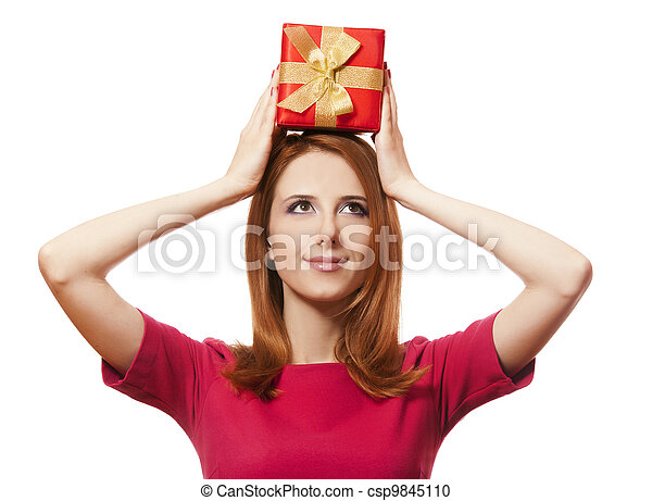 Beautiful red-haired woman with present box. - csp9845110