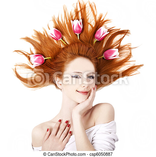 Beautiful red-haired woman with tulips. - csp6050887