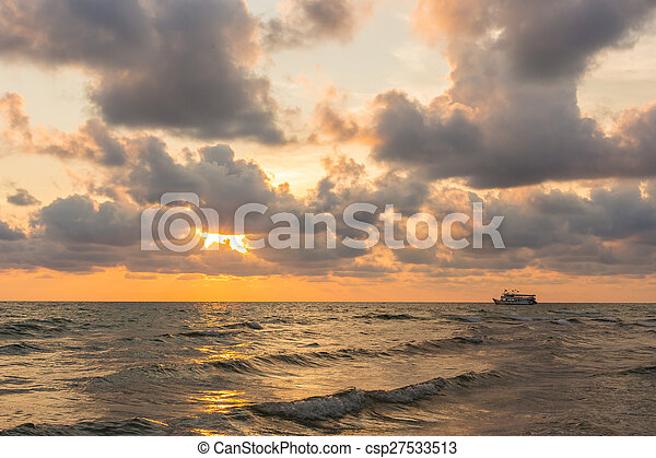 Beautiful red sunset over the ocean - csp27533513