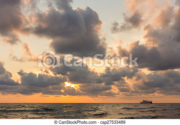 Beautiful red sunset over the ocean - csp27533489