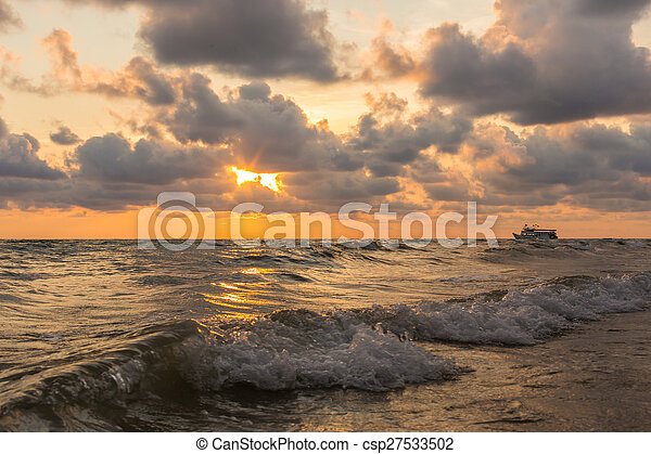 Beautiful red sunset over the ocean - csp27533502