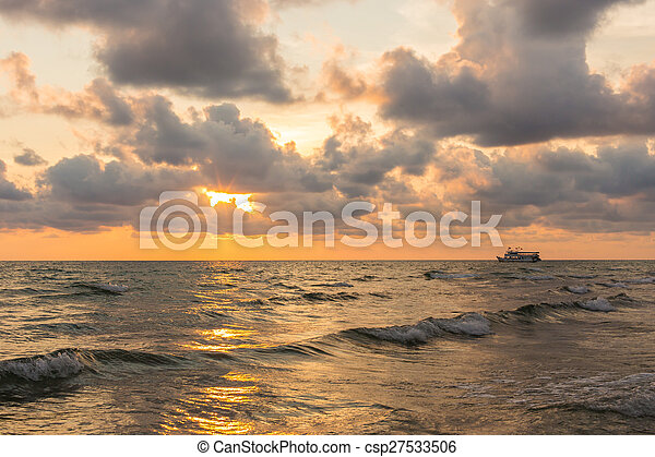 Beautiful red sunset over the ocean - csp27533506
