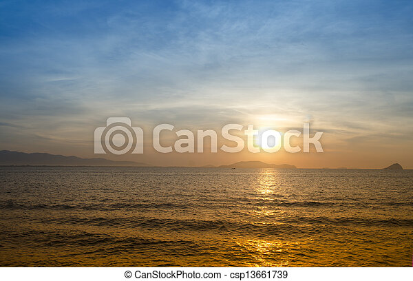 Beautiful red sunset over the ocean - csp13661739