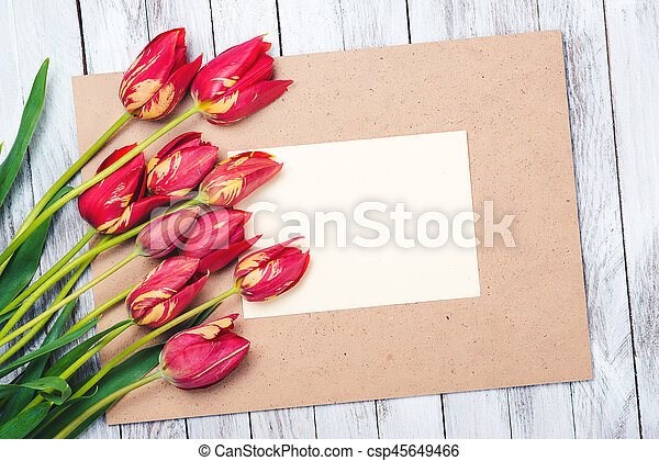 Beautiful red tulips , empty paper sheet on wooden background. Mother's day. - csp45649466