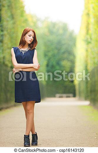Beautiful redhead women in versailles gardens - csp16143120