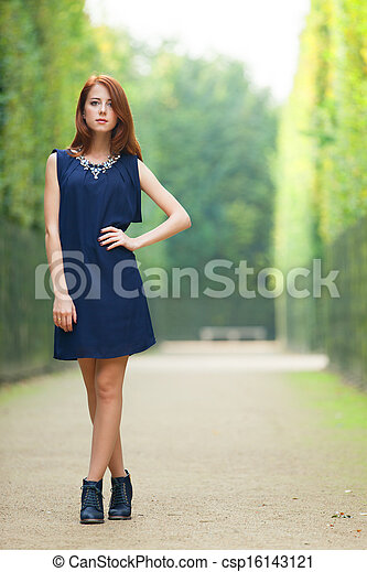 Beautiful redhead women in versailles gardens - csp16143121