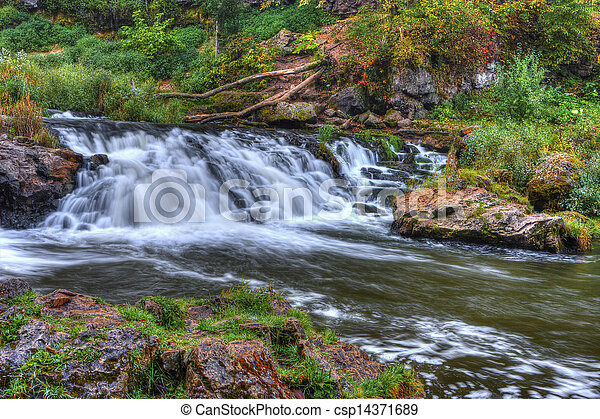Beautiful River Waterfall in HDR High Dynamic Range - csp14371689