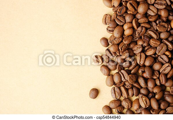 Beautiful roasted coffee beans on yellow background - csp54844940