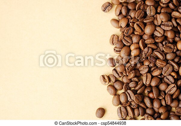 Beautiful roasted coffee beans on yellow background - csp54844938