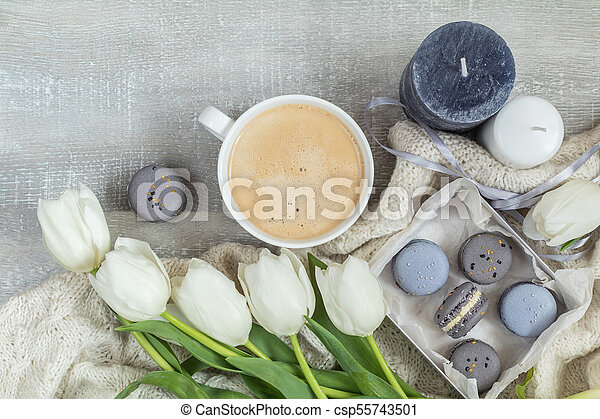 Beautiful romantic composition with coffee, sweet food and flowers - csp55743501