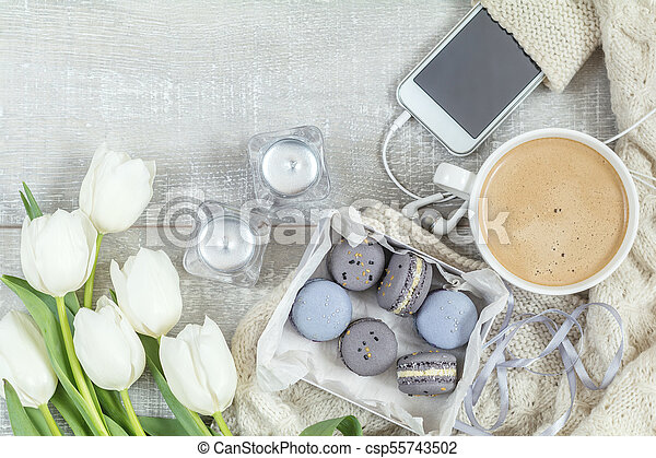 Beautiful romantic composition with coffee, sweet food and flowers - csp55743502