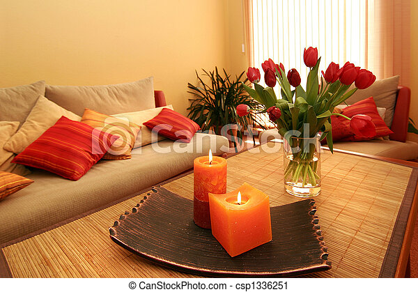 Beautiful room interior with flowers and candles - csp1336251