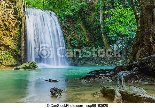 Beautiful scenery of Erawan Waterfall in Kanchanaburi, Thailand. - csp66163628