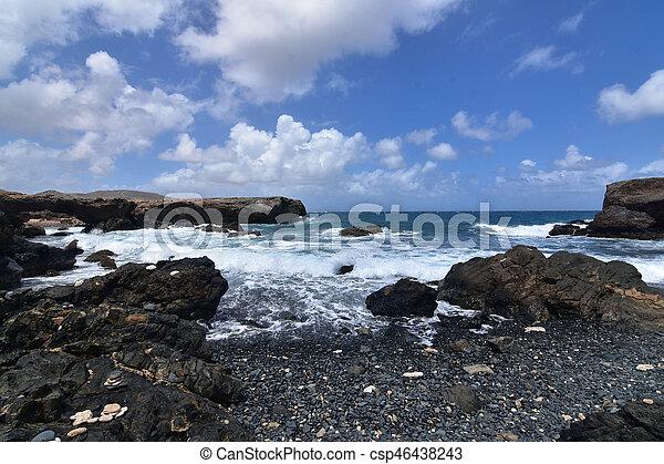 Beautiful Seascape of Aruba's Black Pebble Beach in Aruba - csp46438243