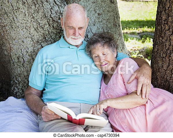 Beautiful Senior Couple Reading - csp4730394