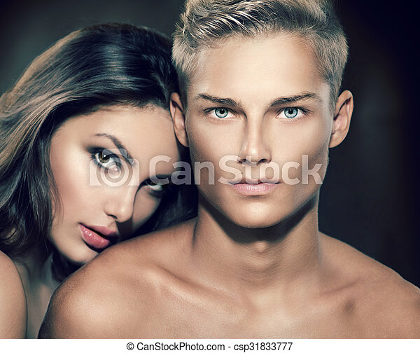 Beautiful sexy couple portrait. Model man with his girlfriend posing together - csp31833777