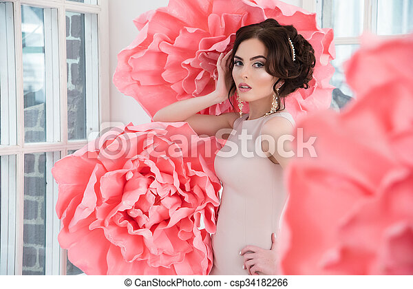 Beautiful Sexy Girl In A Long Dress With A Huge Pink Flowers Sitting