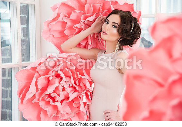Beautiful sexy girl in a long dress with a huge pink flowers beautiful sexy girl in a long dress with a huge pink flowers sitting by the window mightylinksfo