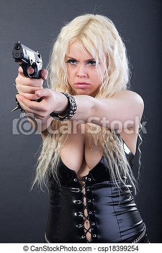 Girl sexy holding gun blonde
