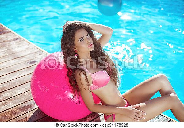 Sexy girl in pink bikini