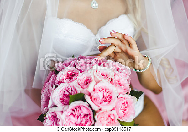70b623fe62c Beautiful Sexy Young Bride Underwear Sitting On A Bed With A Bouquet Of  Flowers In Hands And With A