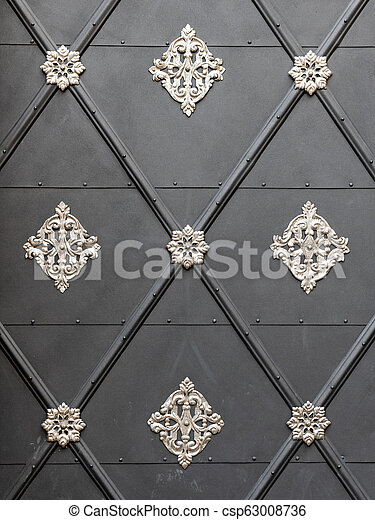 Beautiful silver decoration on a gray door - csp63008736